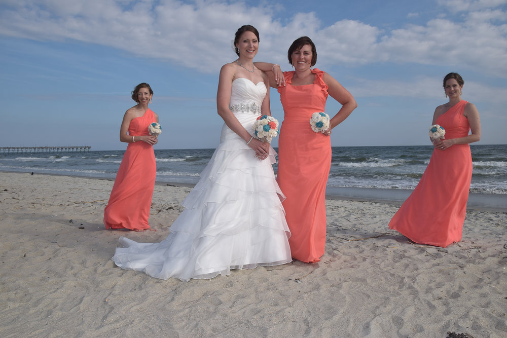 Bride posing with bridesmaids.