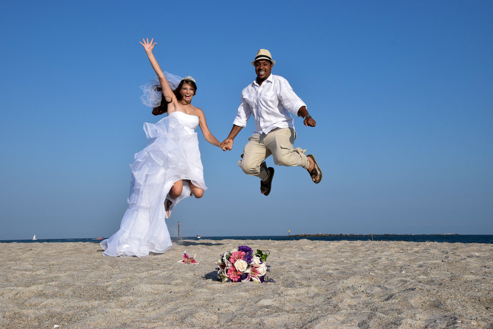 Bride and Groom beach leap.