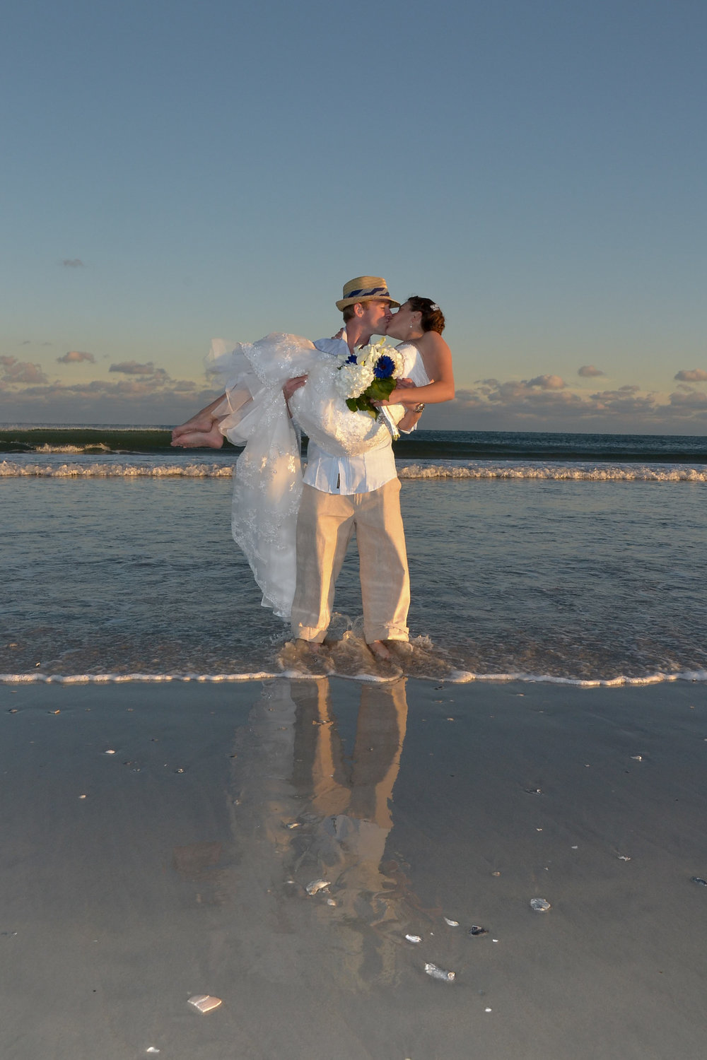 Newly married couple at beach.