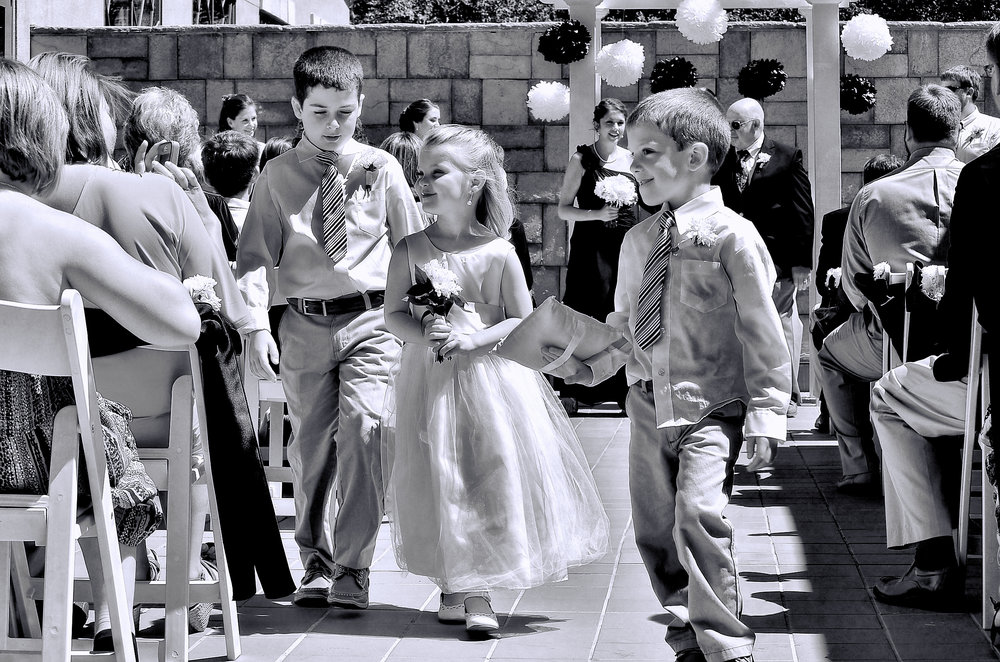 Flower girl and ring bearer walking.