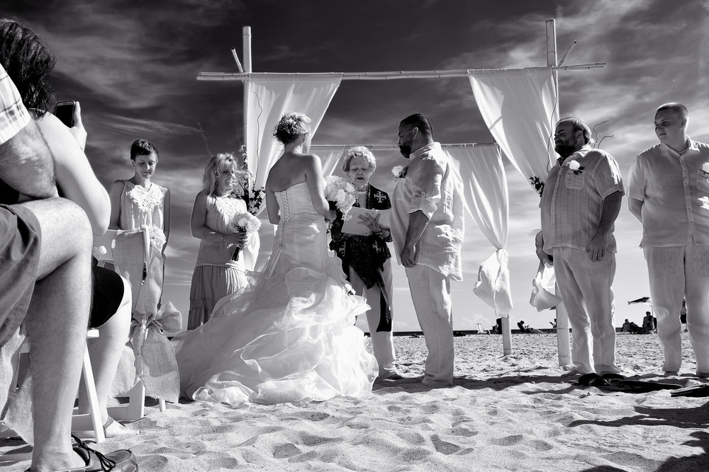 Black and white beach ceremony.