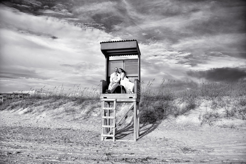 Bride and groom in lifeguard stand.