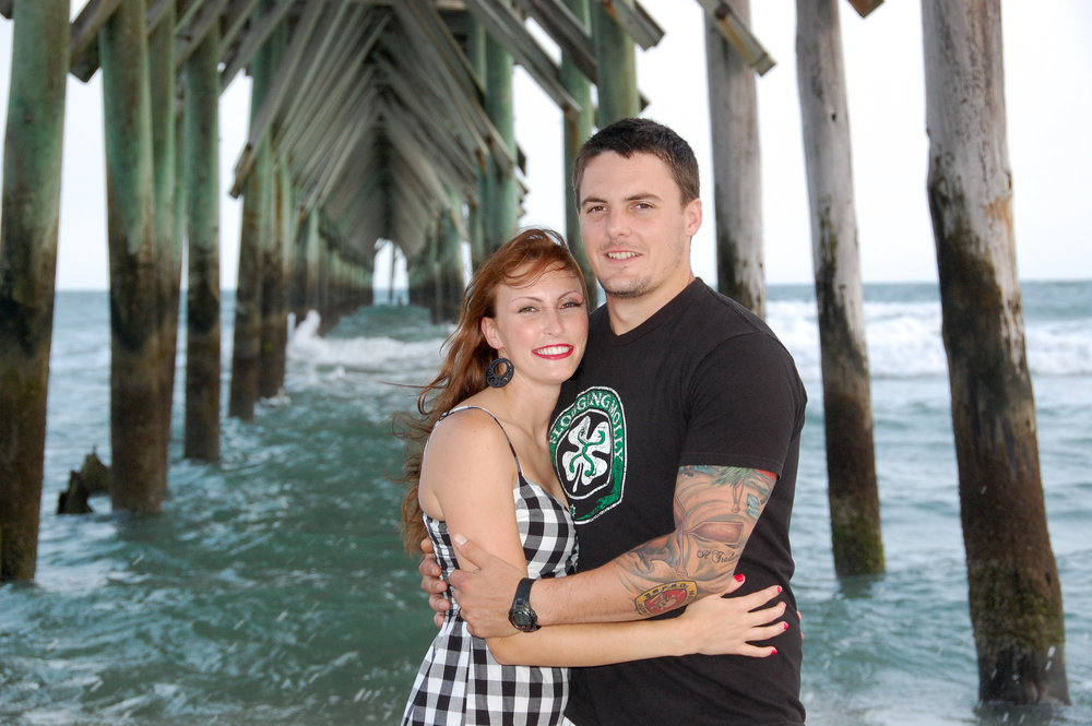 Engagement portrait under pier.