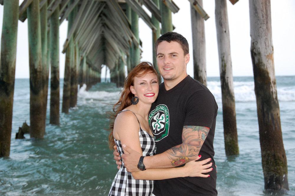 Engagement portrait under pier.