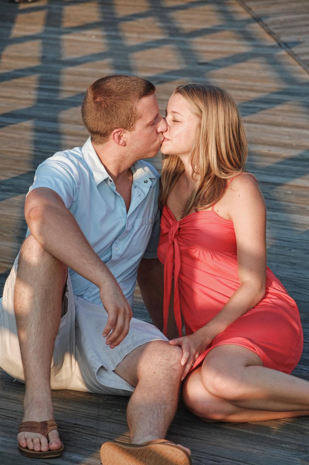 Engagement portrait, riverwalk in Wilmington, NC.