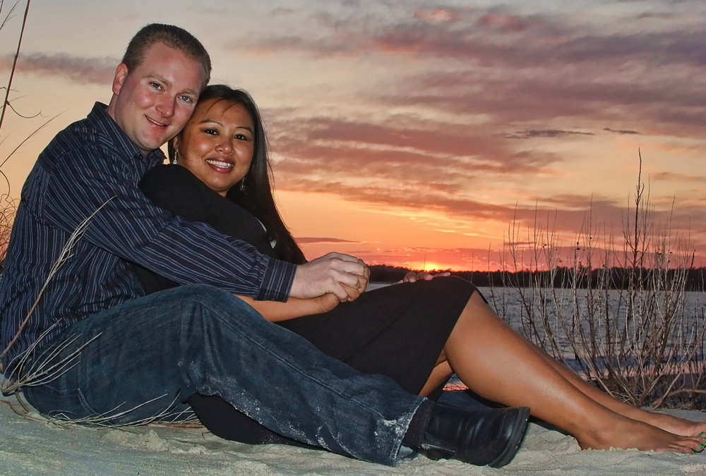 Sunset engagement photo at Wrightsville Beach, NC.
