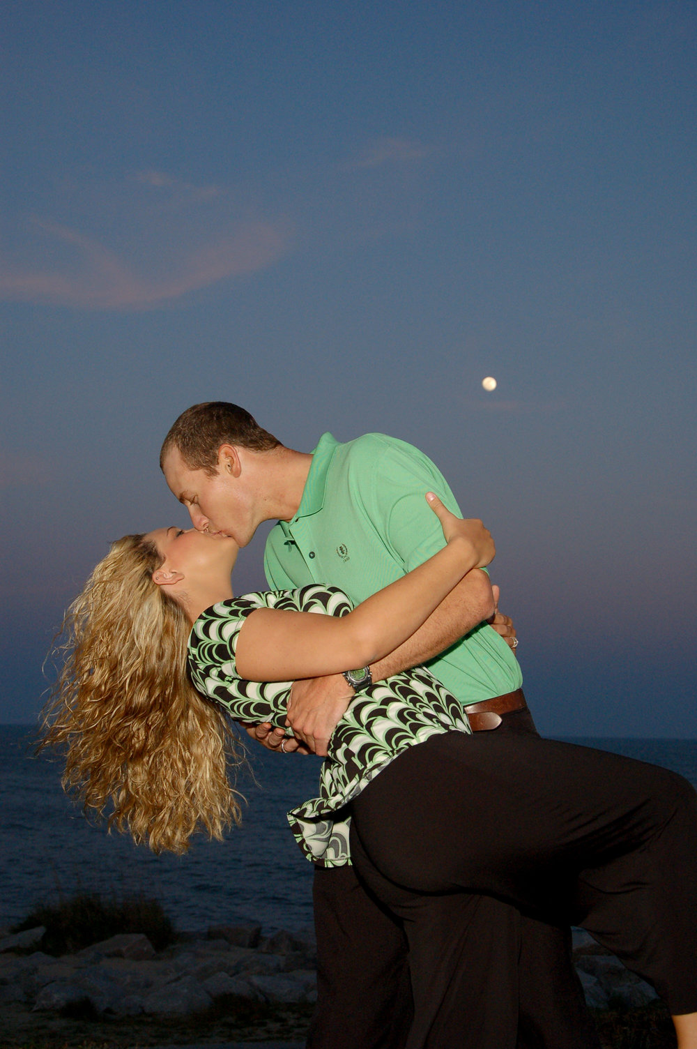 Full moon engagement portrait.