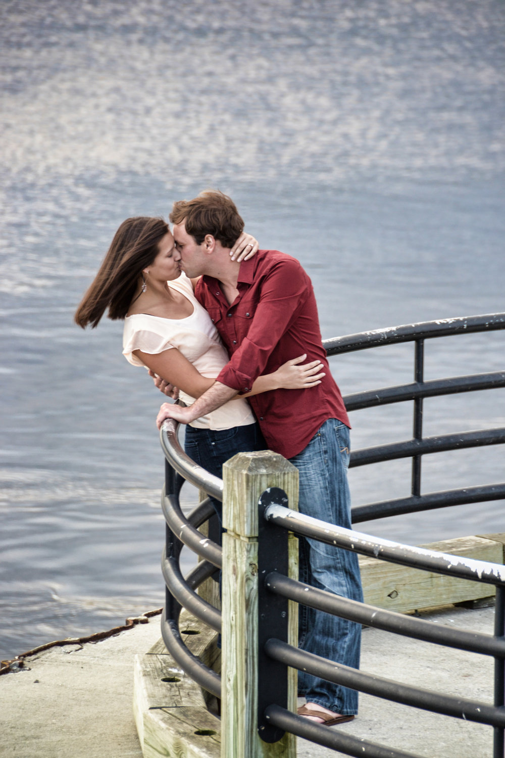 Candid engagement portrait, downtown Wilmington, NC.
