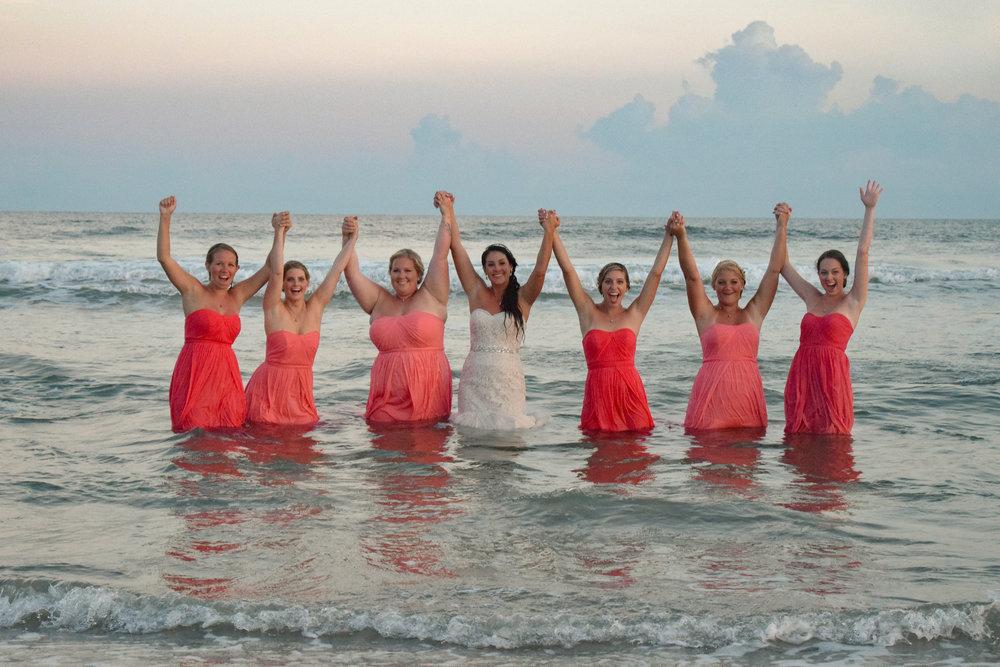 Bride and bridesmaids celebrating in the Ocean at Ocean Isle Beach, NC.