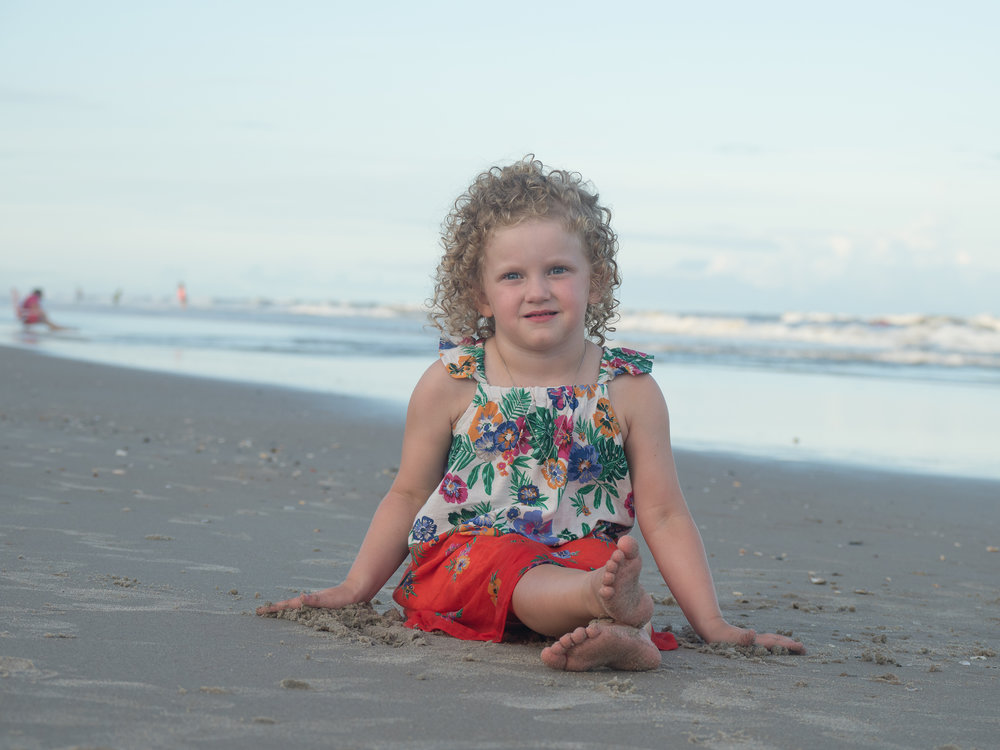 - Cute portrait of little girl on beach. Topsail Island, NC