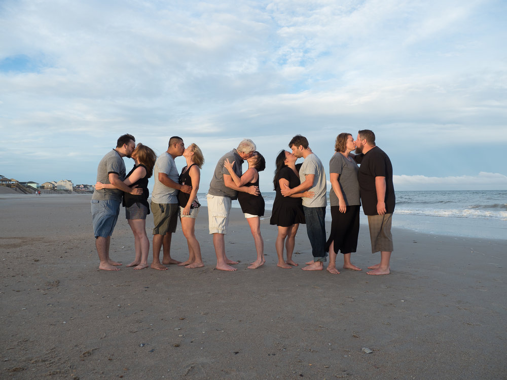 - Love this shot. All the married couples kissing on the beach with the ocean in the background. North Topsail Beach, NC.