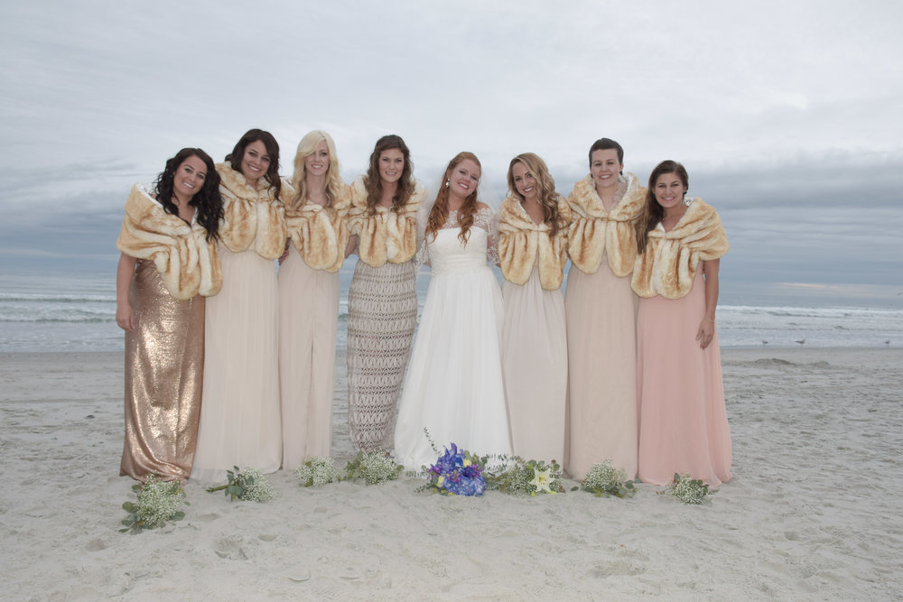 - Bride and bridesmaids on a cold January Beach. Wrightsville Beach, NC.
