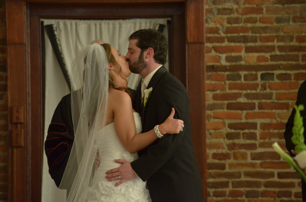 - First kiss at St. Thomas Preservation Hall in Wilmington, NC. Billy Beach Photography.