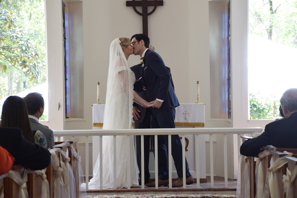 - First kiss at the Lebanon Chapel in Airlie Gardens, Wilmington, NC. Billy Beach Photography.