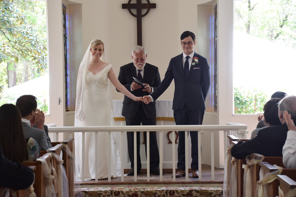 - Presenting the bride and groom at the Lebanon Chapel, Airlie Gardens in Wilmington, NC. Billy Beach Photography.