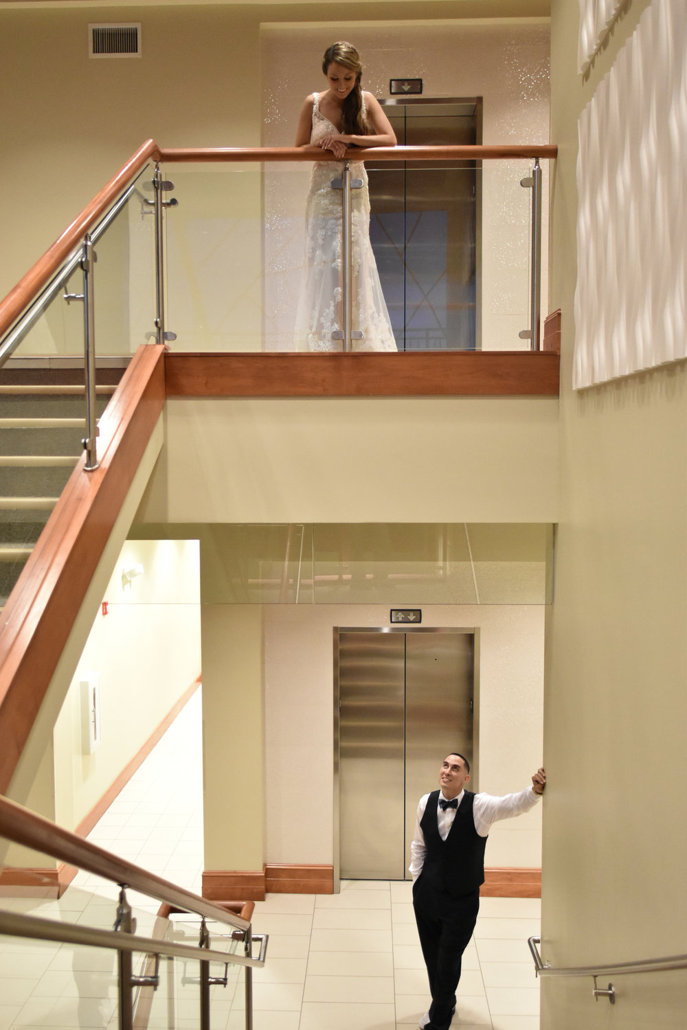 Stairs - Fun Shot. Took image of Bride looking down on husband on the 2nd and 3rd floors of the Terraces on Sir Tyler in Wilmington, NC.