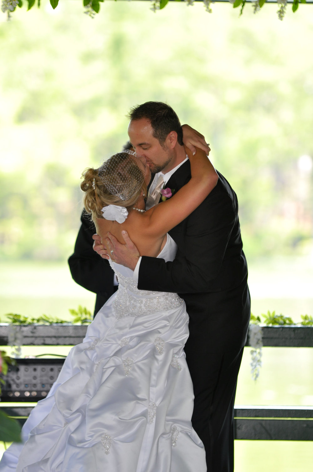 - First Kiss at the Fragrance Garden, Greenfield Lake, Wilmington, NC. Billy Beach Photography. Affordable Wedding.
