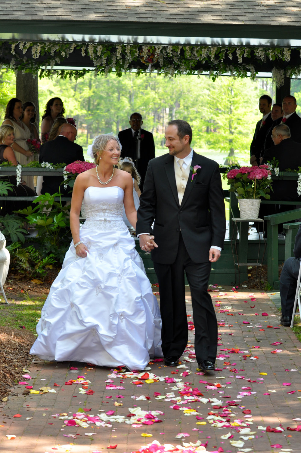 - Married. Walking up the aisle at the Fragrance Garden in Greenfield Lake in Wilmington, NC. Billy Beach Photography. Affordable wedding.