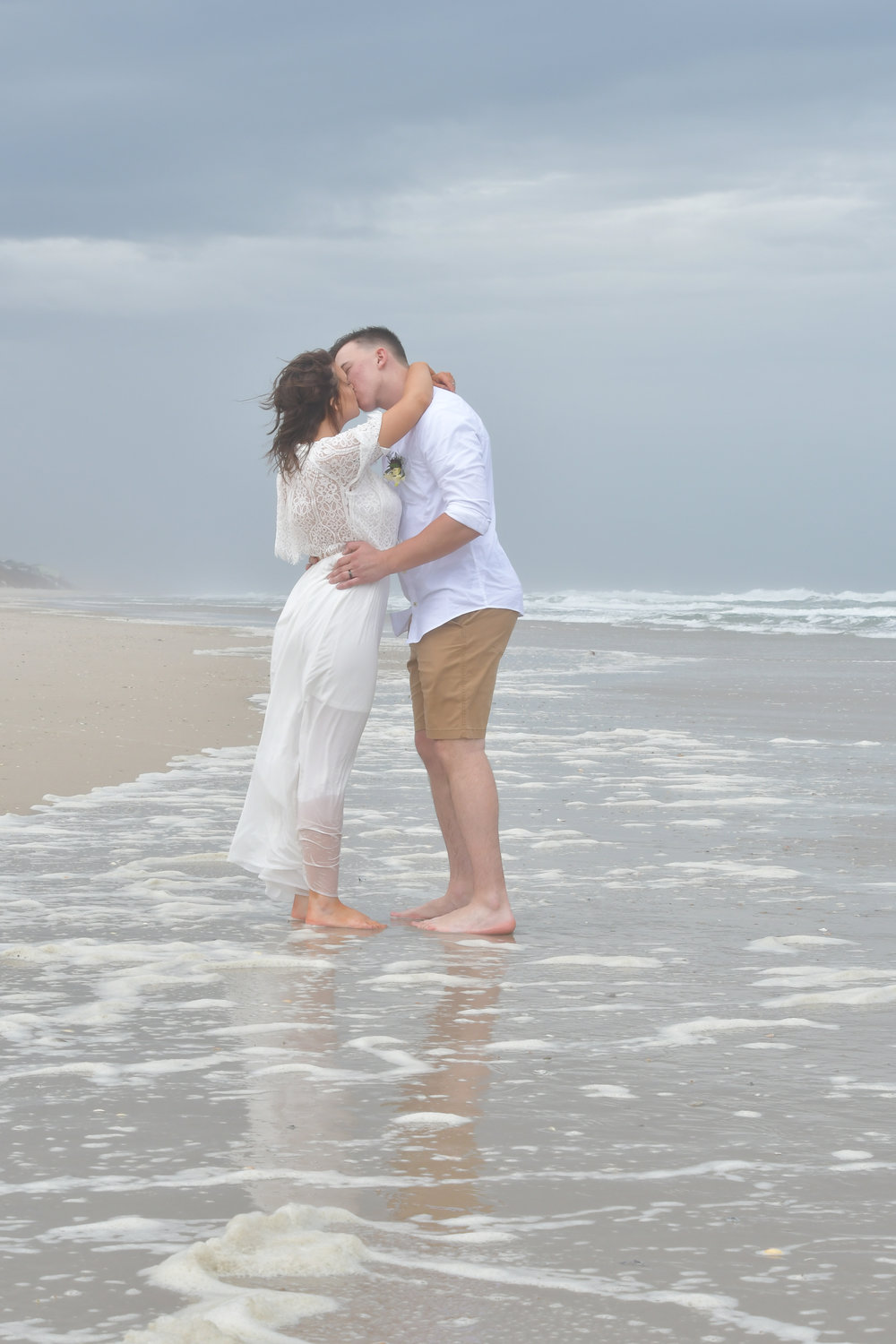 Kiss - Sharing a kiss in the surf in Surf City, Topsail Island, NC. Billy Beach Photography.