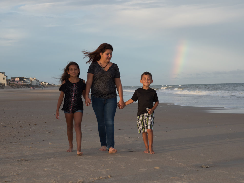 - Mom and two boys walking on the beach with rainbow in background. Topsail Island. Billy Beach Photography.
