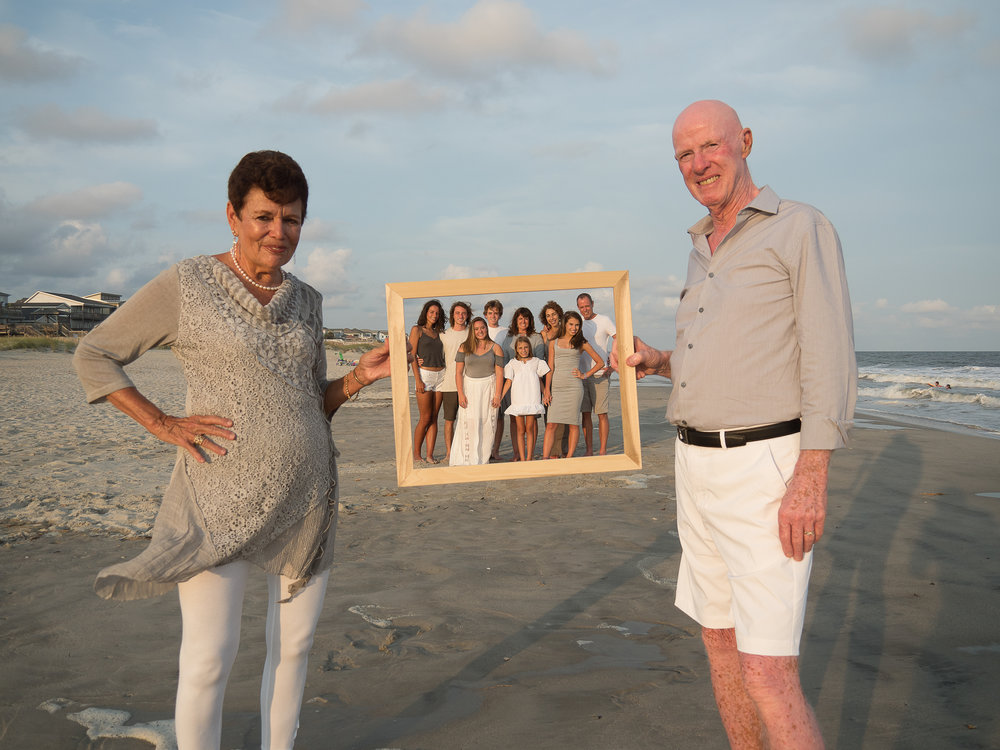 - Love some props sometimes. Grandparents holding frame with kids and grandkids. Ocean Isle Beach, NC. Billy Beach Photography.