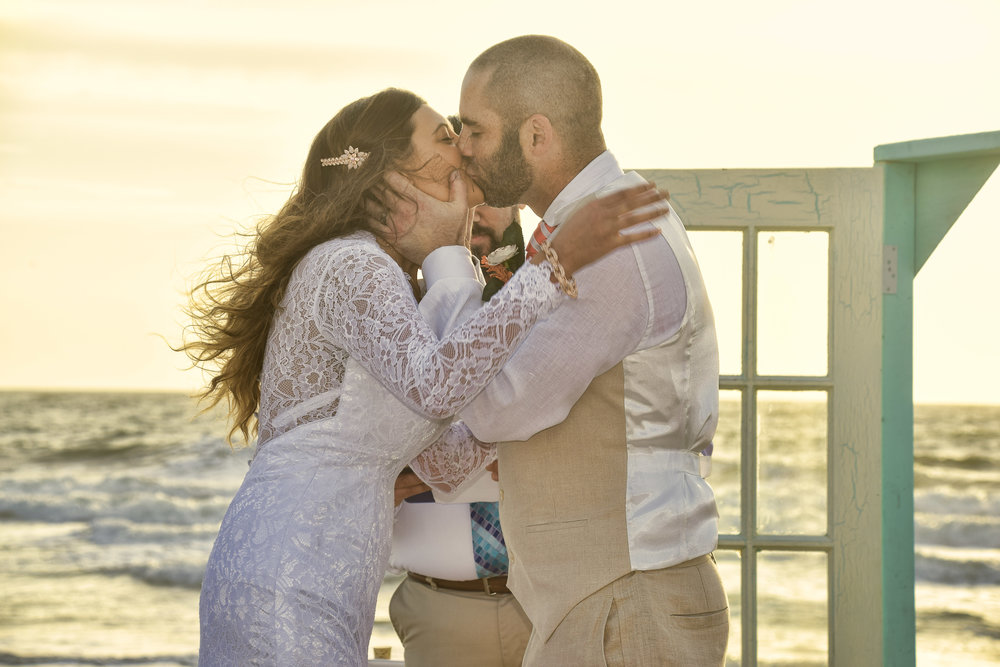 Kiss - First kiss at a sunrise wedding in Carolina Beach, NC. Billy Beach Photography.