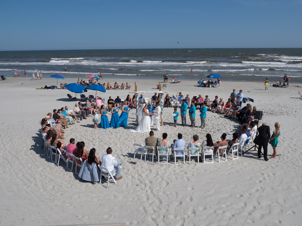 Daytime - A daytime beach wedding. Still a great wedding, but the beach was packed. I love the chair design.