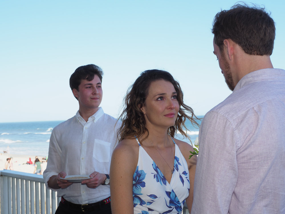 Vows - Reciting the vows. Wrightsville Beach, NC