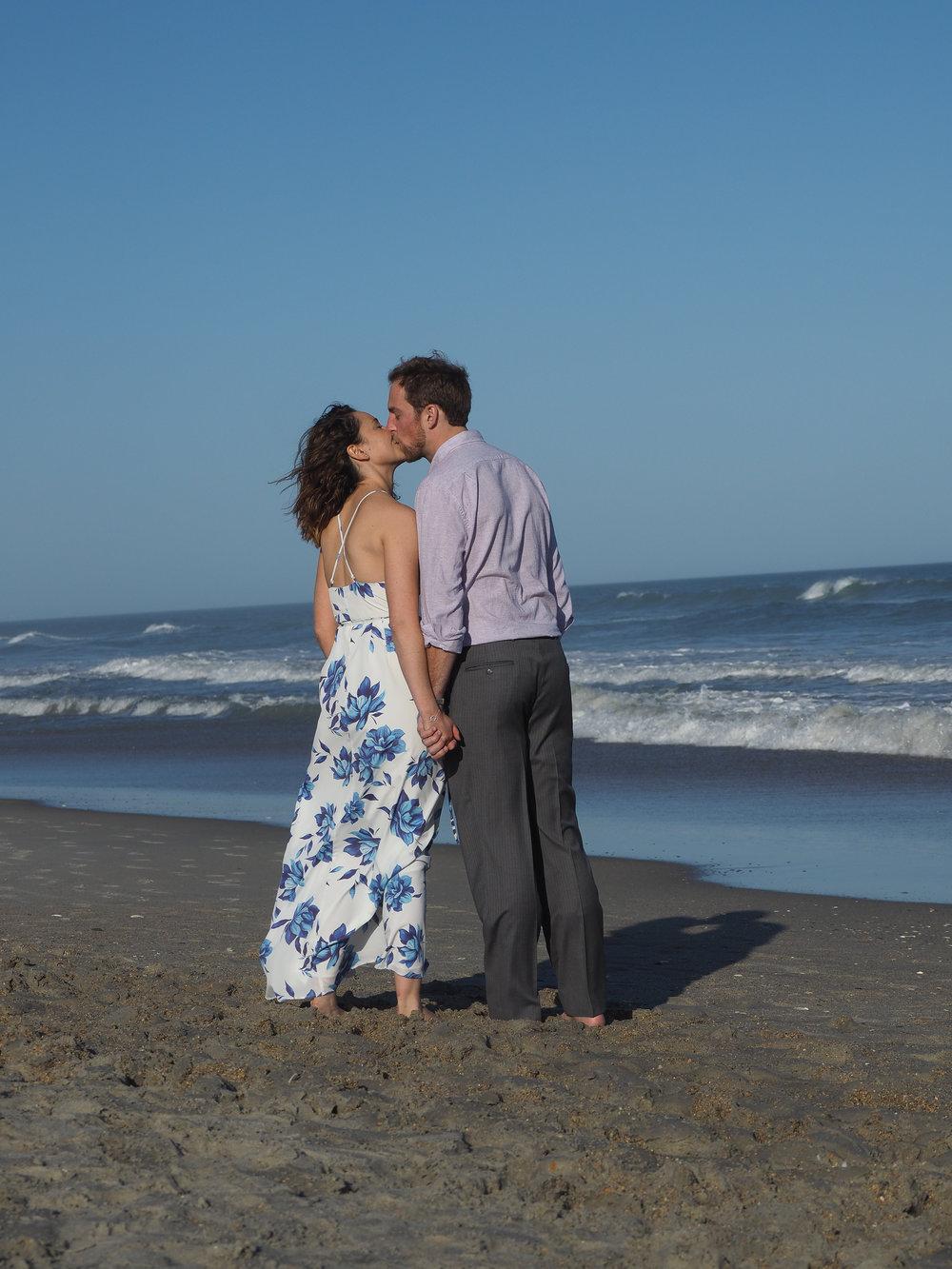- A walk on the beach, sharing a romantic moment. Wrightsville Beach, NC. Billy Beach Photography.