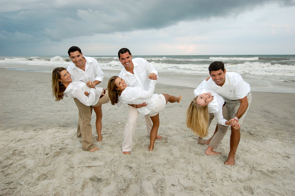 - Three brothers dipping their wives at Topsail Beach, NC.