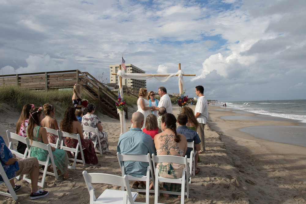 - High Tide at the beach. The original plan was to have the chairs facing the ocean. Ended up getting married on a narrow strip.