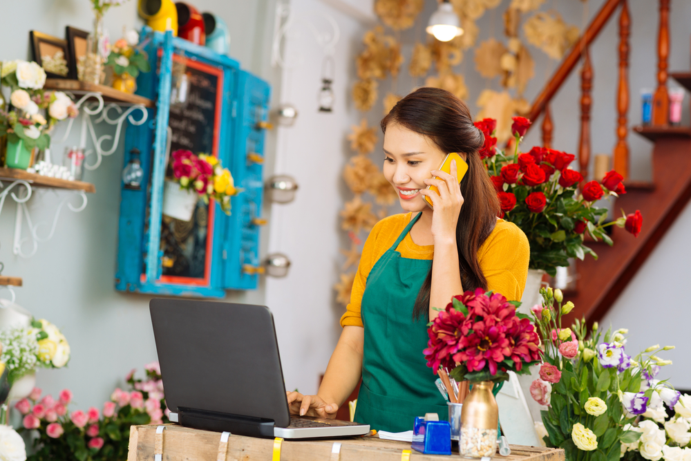 flower-shop-girl-working-online-business-laptop.jpg