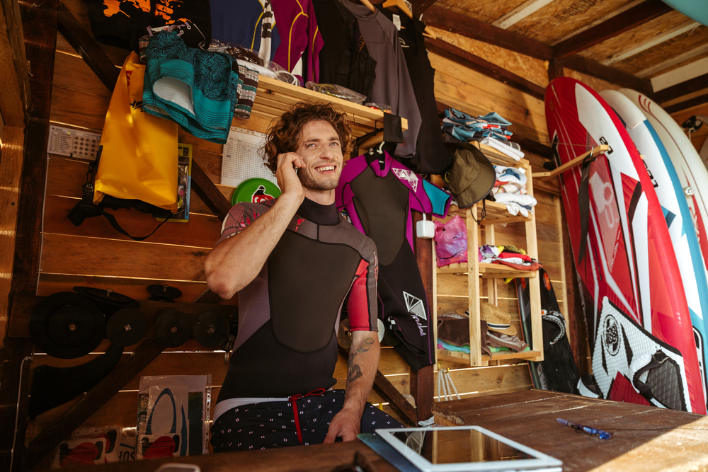 surf-man-on-smartphone-growing-online-business-of surf goods.jpg