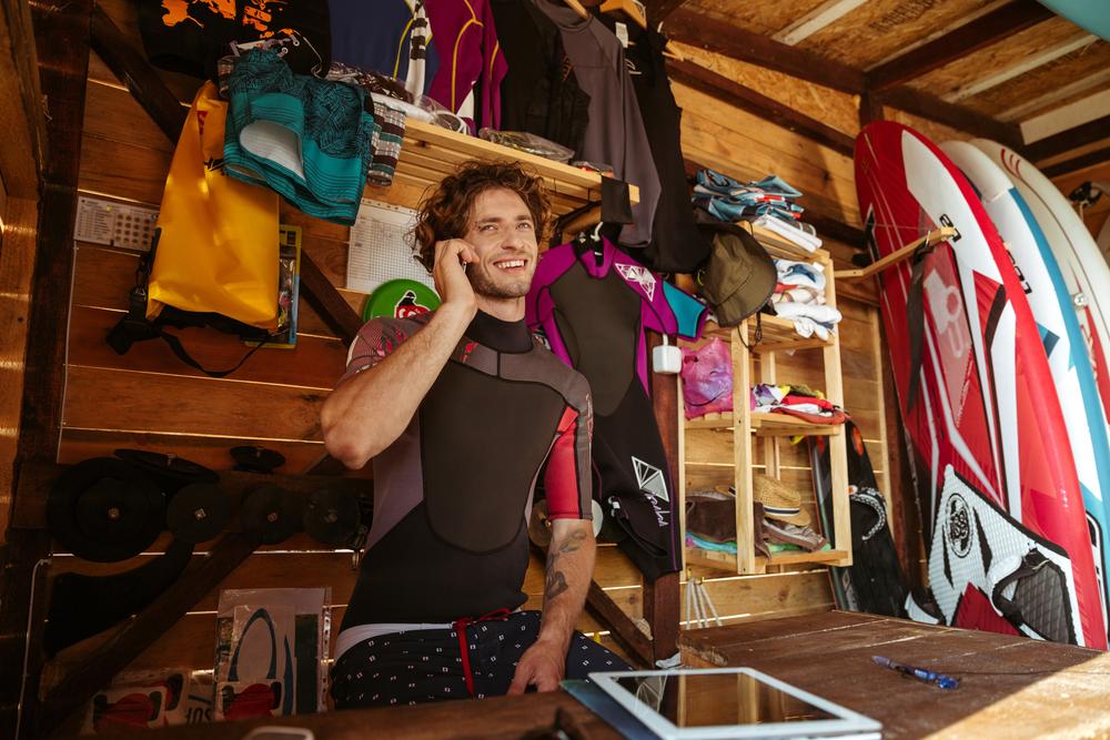 surf-man-on-smartphone-growing-online-business-of surf goods.jpg