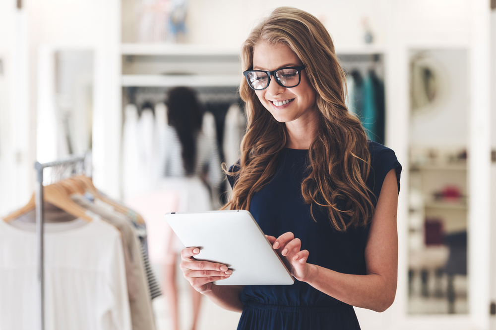 girl-working-on-ipad-in-retail-clothing-shop.jpg