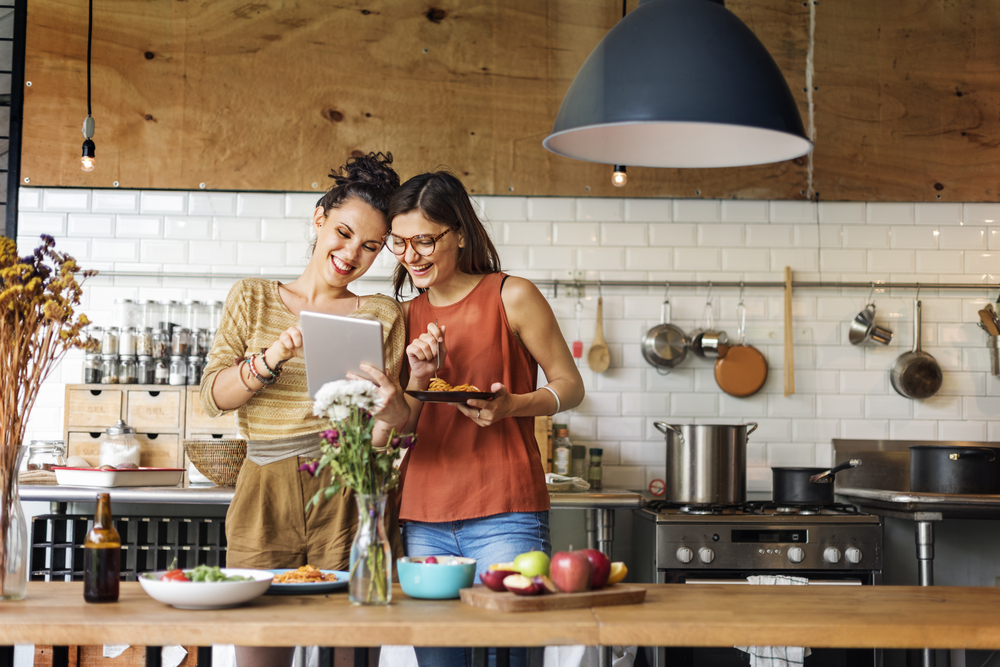 two-woman-online-shopping-tablet-in-kitchen.jpg