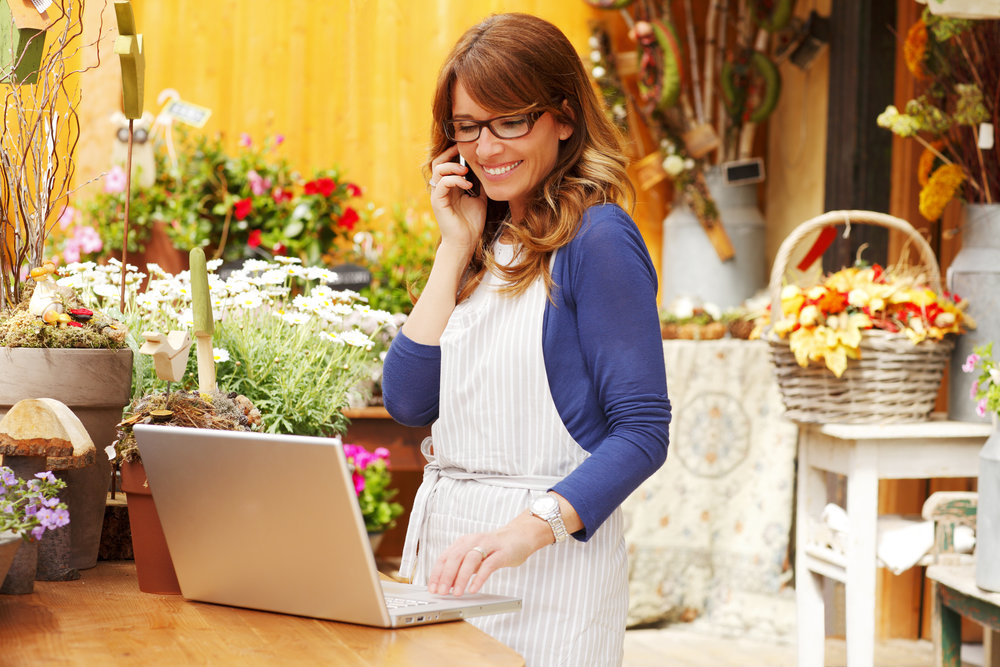 woman-working-laptop-in-start-up-flower-shop-taking-orders.jpg