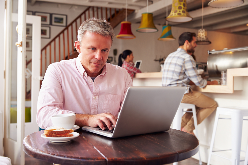 man-learning-digital-business-on-laptop-in-cafe.jpg