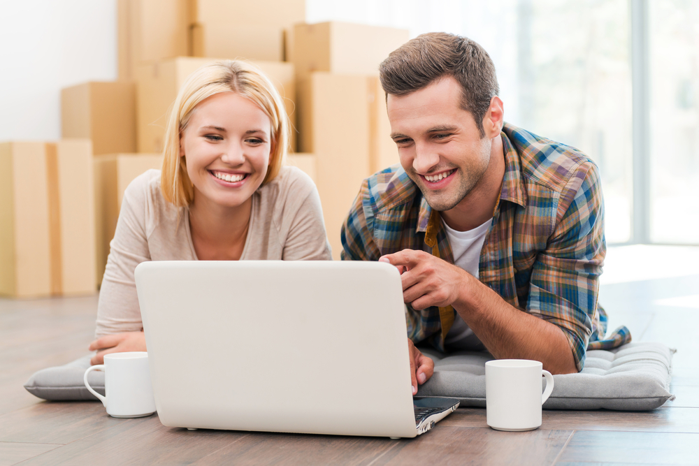 couple-lying-on-floor-new-warehouse-selling-online-products-in-boxes.jpg