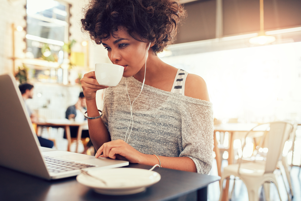 woman-sipping-tea-working-online-business-on-laptop-in-coffee-shop.jpg
