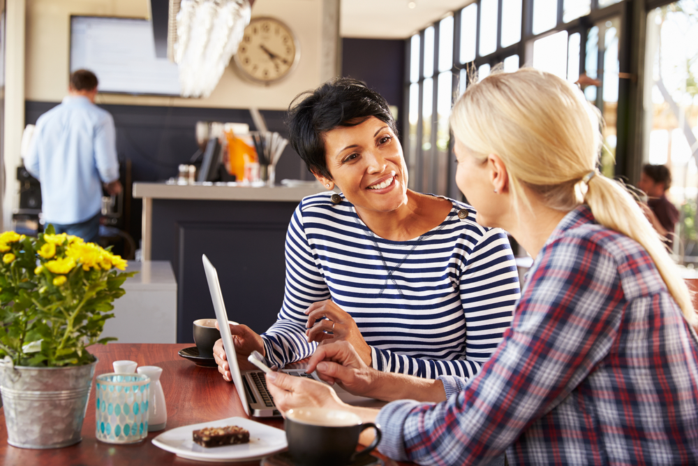 ladies-working-on-online-business-idea-on-laptop-in-cafe.jpg