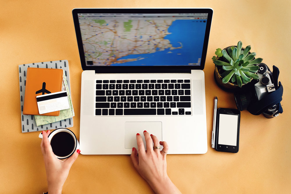 person-working-on-travel-website-at-desk.jpg