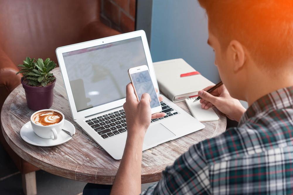 man-working-on-his-digital-business-having-coffee.jpg
