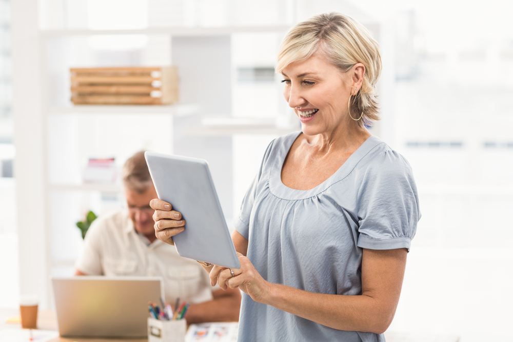 senior-lady-with-husband-working-online-project-on-ipad-happy.jpg