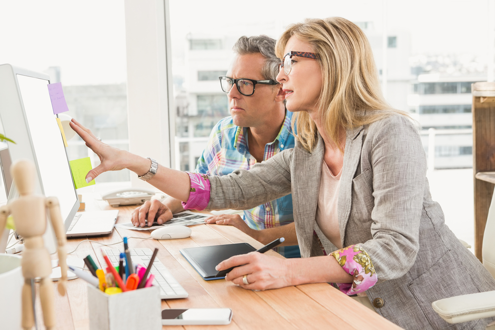mature-couple-working-on-new-website-in-office.jpg