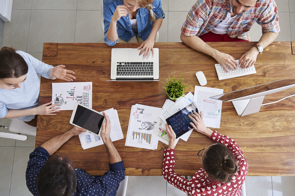 web-design-group-brain-storming-website-ideas-on-table.jpg