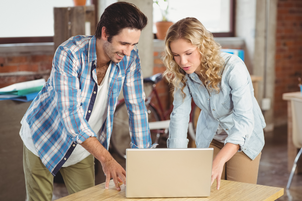 young-couple-wokring-on-laptop-for-ecommerce-business.jpg