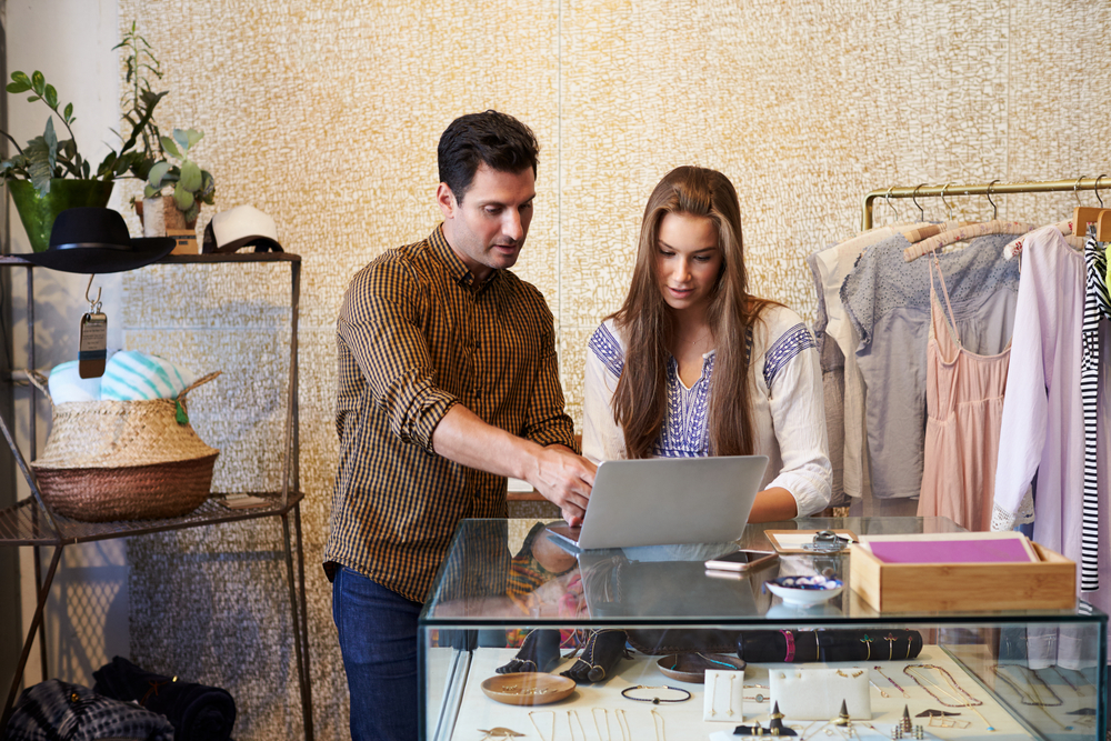 couple-learning-how-to-start-fashion-business-online-in-fashion-store-on-laptop.jpg