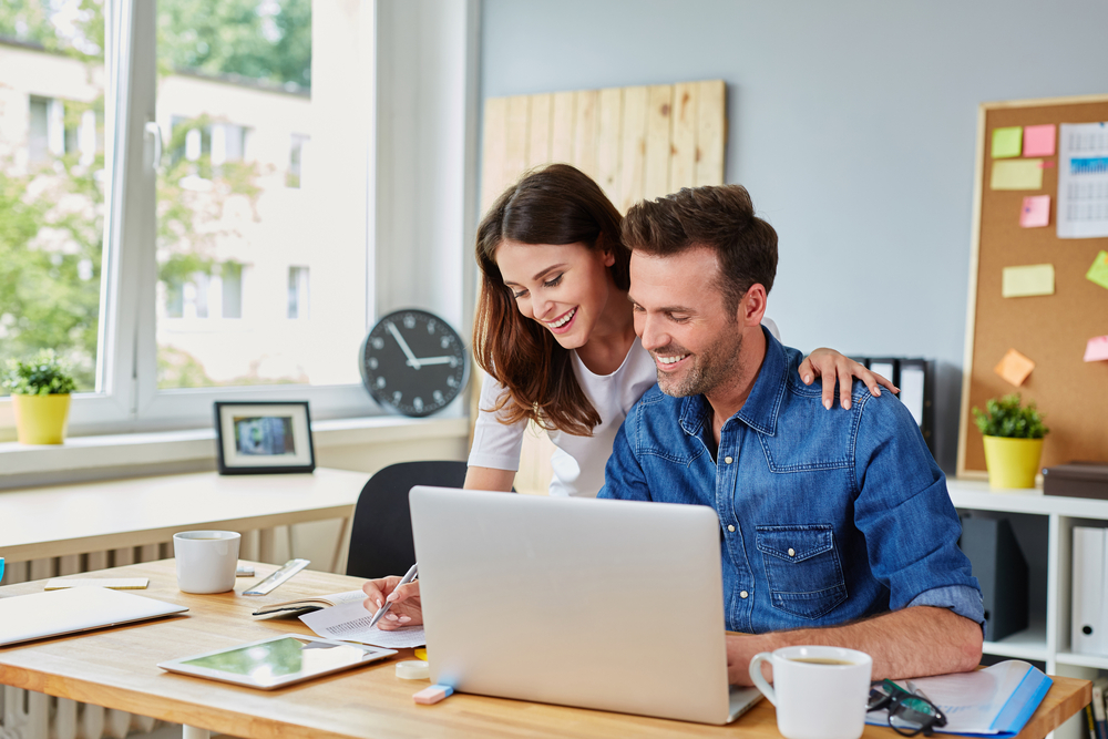 couple-working-online-business-supporting-each-other-happily-in-home-office.jpg