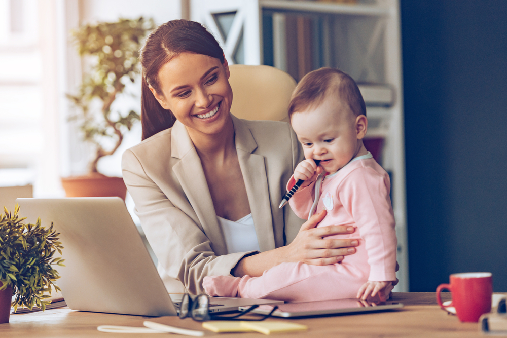 mum-with-baby-trying-to-work-on-online-business-on-laptop.jpg